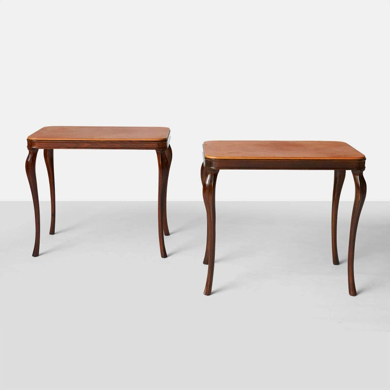 A pair of mahogany framed side tables with