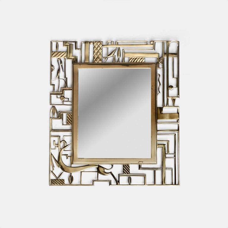 Cast brass mirror, circa 1925 - for Werkstate Hagenauer a wall mirror, designed by Karl Hagenauer for the Werkstätte Hagenauer, Vienna, 1924/25, cast brass, marked: HAGENAUER/WIEN WHW/MADE IN AUSTRIA,  Literature: comp. 60 Jahre Galerie Würthle. 60
