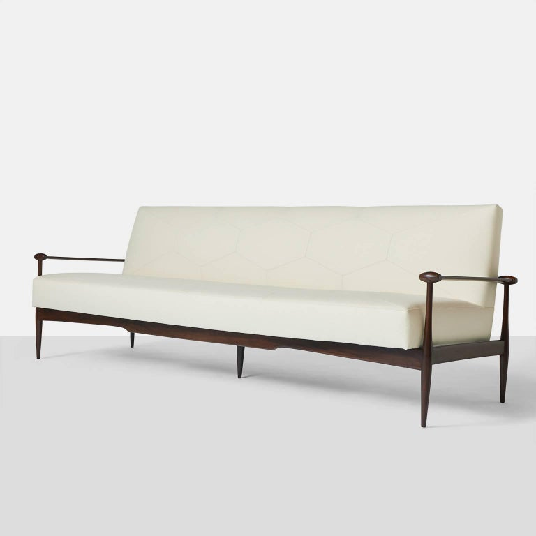 A very rare and impressive sofa by Liceu de Arte e Officios restored in a luxuriously soft wool fabric from Holland & Sherry. The sofa fabric was cut and sectioned with baseballs stitching using the same geometric pattern as was originally used on