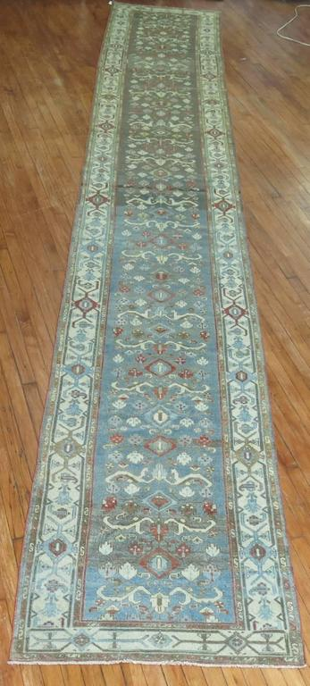 Early 20th century abrashed Persian Malayer runner. Accents in icy blue, green, brown and peppermint red.