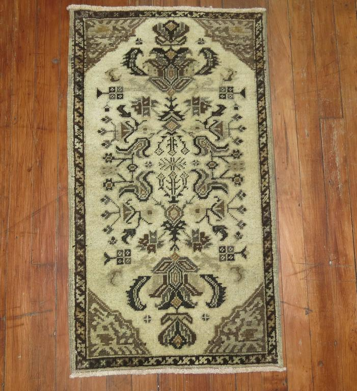 A complimentary pair of one of a kind vintage Turkish rugs in beige and brown. Measuring 1'8'' x 3' and 1'7'' x 2'10''.