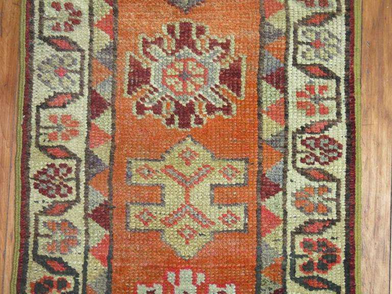 Narrow Turkish Anatolian runner, predominantly orange.   1'11'' x 12'8''