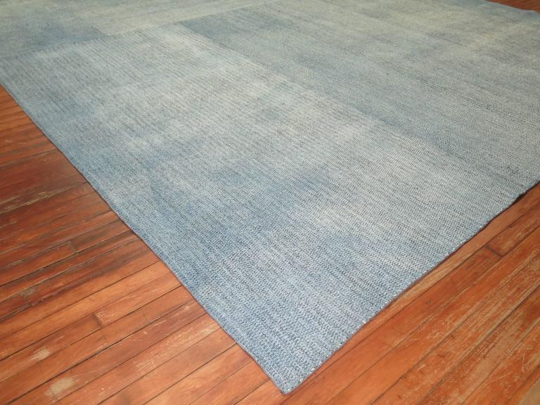 Square size hand-knotted Turkish Kilim in a blotchy aqua blue color. Handwoven by recycled cotton and goat hair material giving it an old world vintage feel.