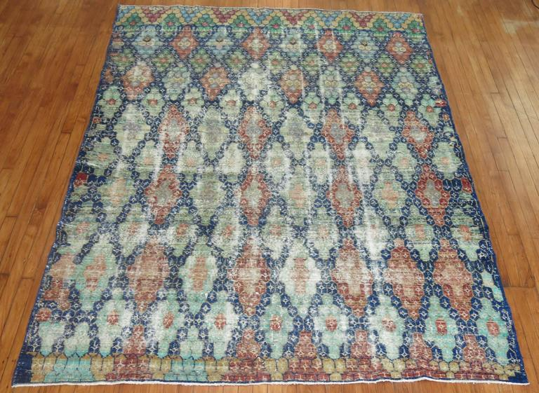 Shabby chic Turkish Anatolian carpet, navy blue field, predominant accents in green, soft red, soft orange, blue and gray.