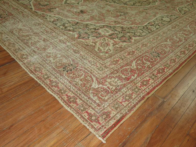 An early 20th century Classic formal style Persian Tabriz rug.