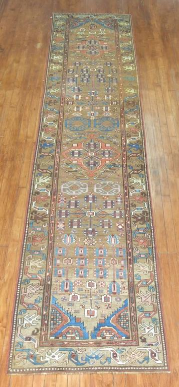 An early 20th century Tribal Persian Bakshaish runner in browns and blue.  Measures: 2'9