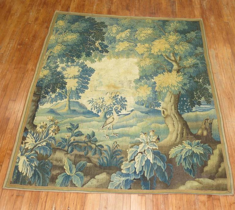 An 18th century French Tapestry. Measures: 6'1'' x 7'4''.