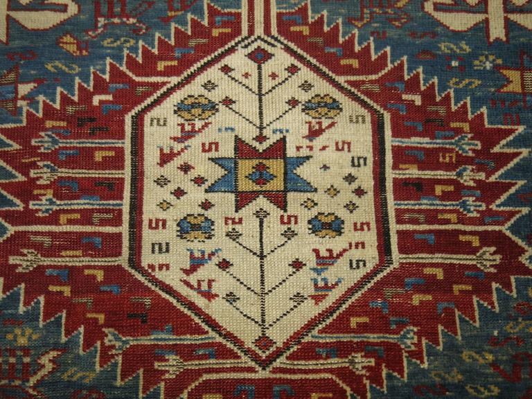 An early 20th century Antique Caucasian shirvan rug with a large-scale geometric pattern on a lovely sky blue field. A collectible and connoisseur rug.