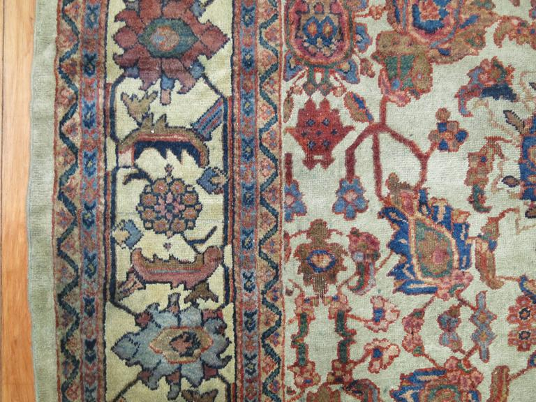 Room size Persian Mahal carpet with an all-over design with a grey field predominant accents in rusty red and blue.
