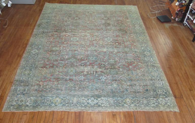 Faded early 20th century antique Persian Mahal rug.