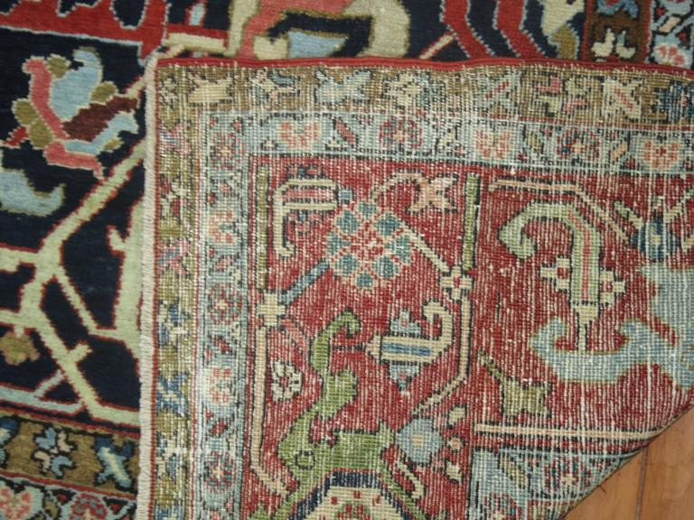 An extraordinary antique Persian Heriz Serapi rug with a rare all-over design.