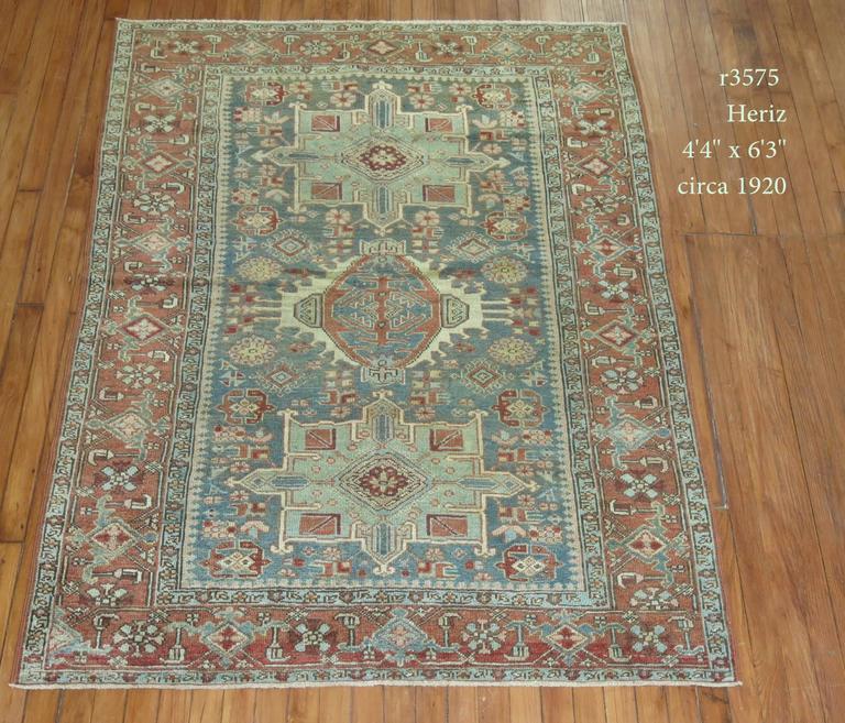 An early 20th century Persian Heriz Karadja rug in earth tones.