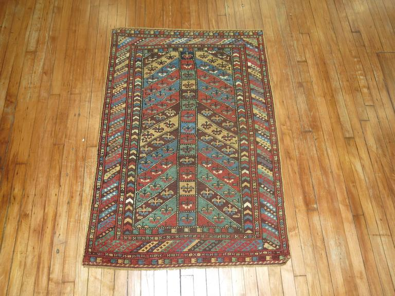 Antique Kurdish rug with a lovely Directional motif derived from 19th century Caucasian rugs.