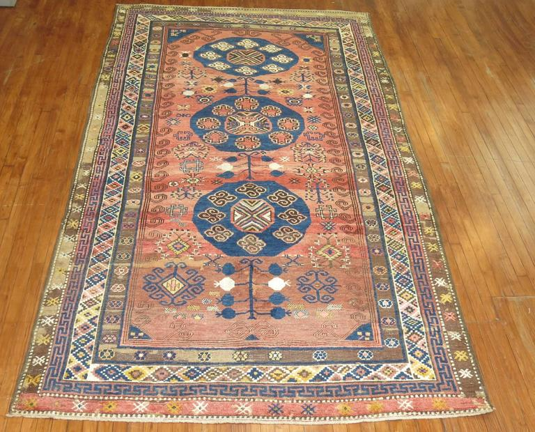 Mid-20th century Turkish village rug derived from a 19th century Asian Khotan rug. The pile construction is thicker giving the rug more durability and longevity. The weave did an amazing job with colors and graphic on the rug.