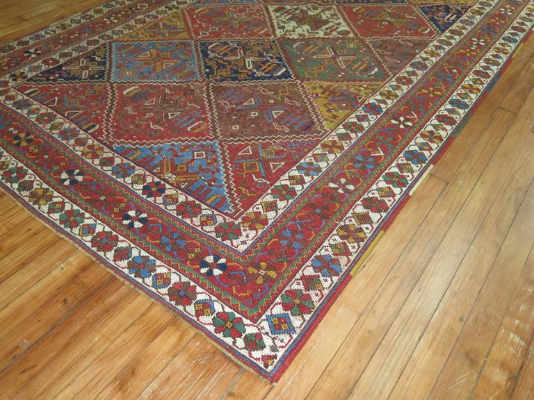 An early 20th century Persian Afshar rug with a colorful all-over diamond shaped design.
