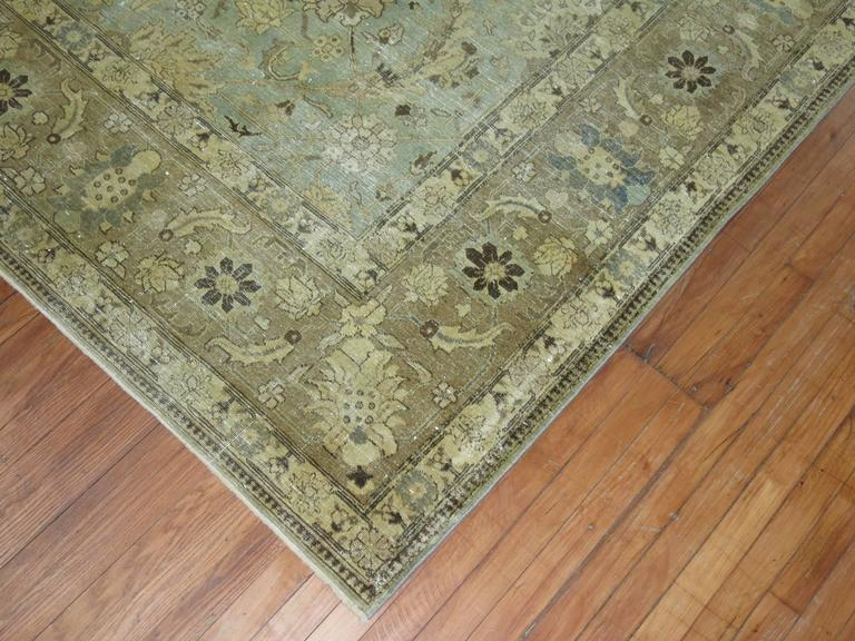 An early 20th century Persian Tabriz carpet in mint green.