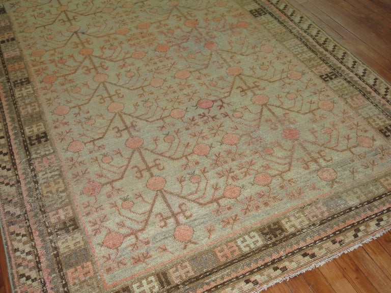 An intermediate size antique Khotan rug.  Measures: 5'8