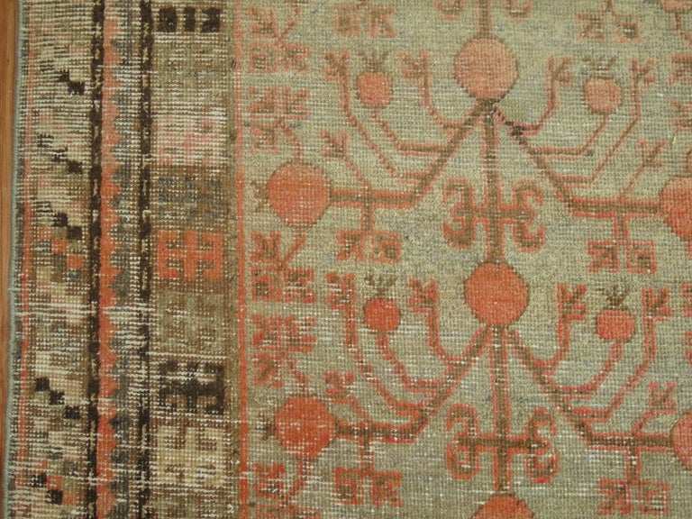 Tibetan Gray Coral Antique Khotan Pomegranate Early 20th Century Rug For Sale