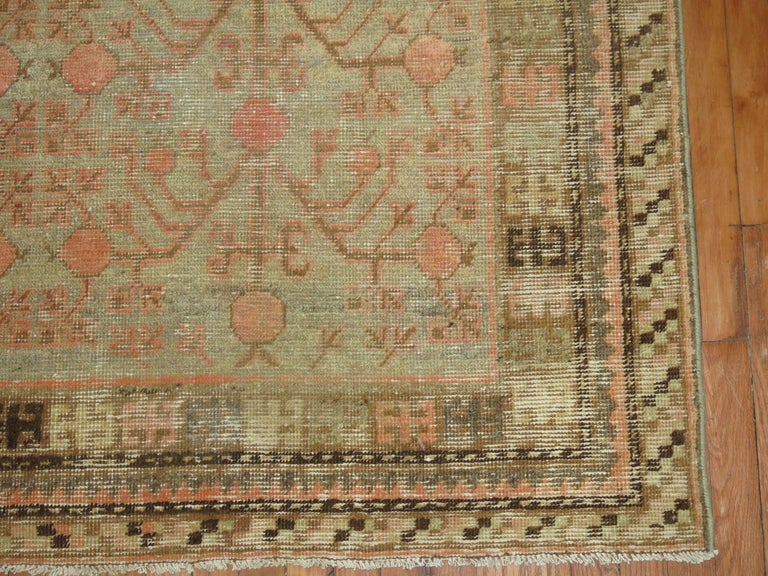 East Turkestani Gray Coral Antique Khotan Pomegranate Early 20th Century Rug For Sale