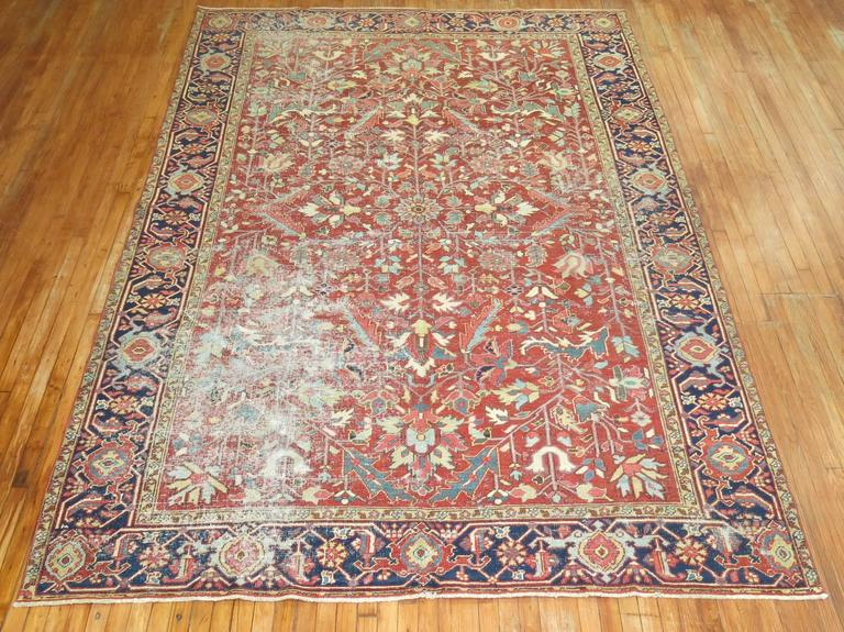 Room size shabby chic Persian Heriz rug featuring an all-over design in cherry red.