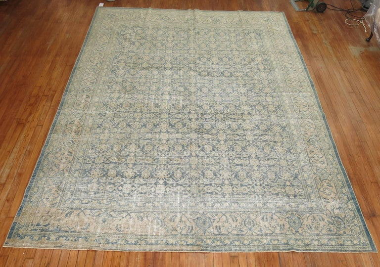 Textured early 20th century Persian Malayer rug with a small-scale all-over herati motif in soft grayish blue and sand tones.