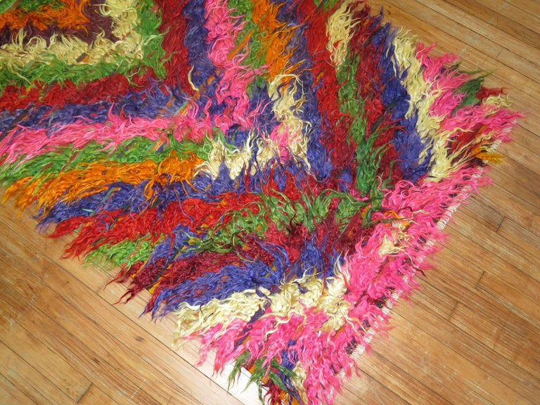 Wild colors highlight this Turkish Tulu Shag rug.