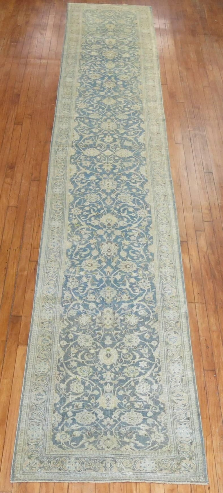 Mid-20th century Persian runner with a soft blue field and accents in sand.
