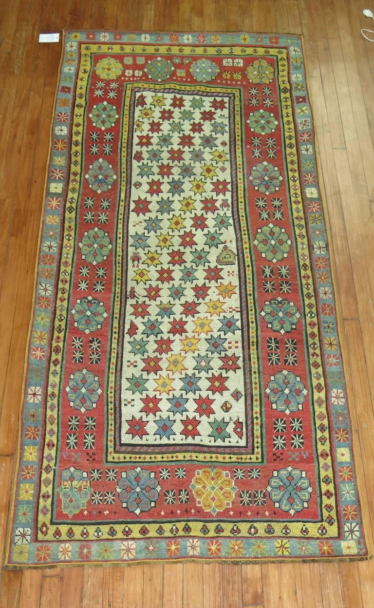 Colorful antique Caucasian Talish intermediate size runner.