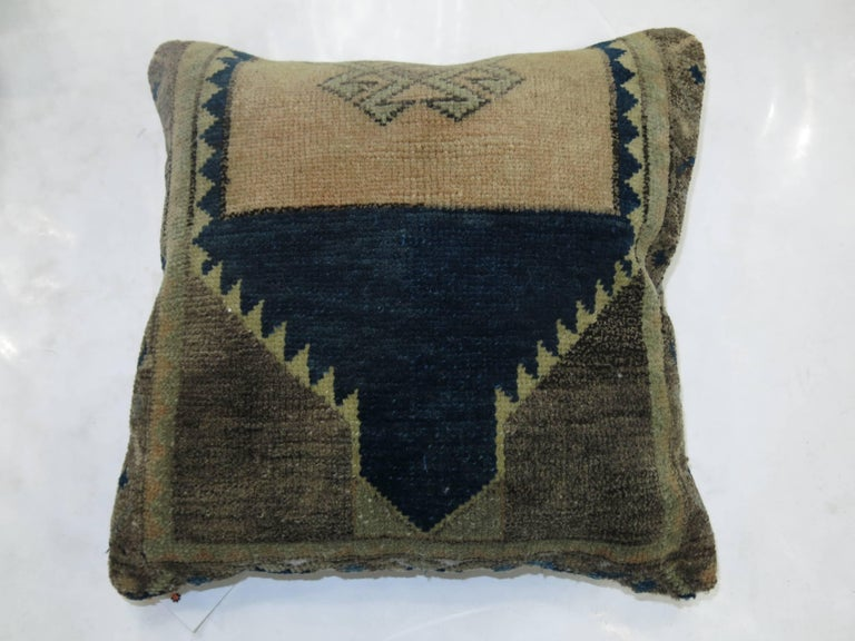 """Pillows made from a set of Turkish rugs in beige, blue, green and tan accents. Measuring 17"""" x 18"""" & 16"""" x 16"""" respectively."""