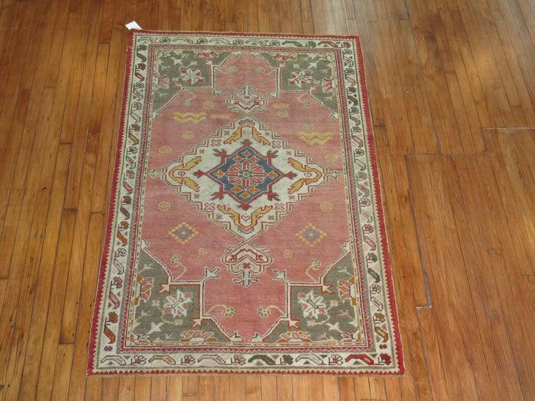 A vintage one of a kind turkish oushak rug.