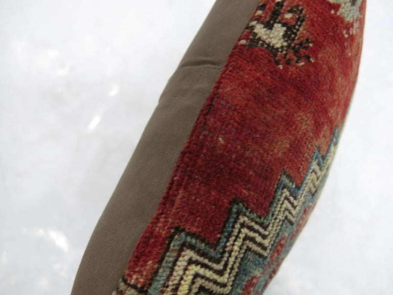 Lumbar size pillow made from a vintage Turkish rug.  14'' x 21''
