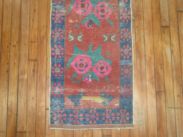Mid-20th century turkish runner with an all over repetitive flower design. dated 1965