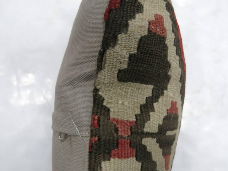Pillow made from a vintage Turkish kilim with cotton back. Zipper closure and foam insert provided. Measures: 16