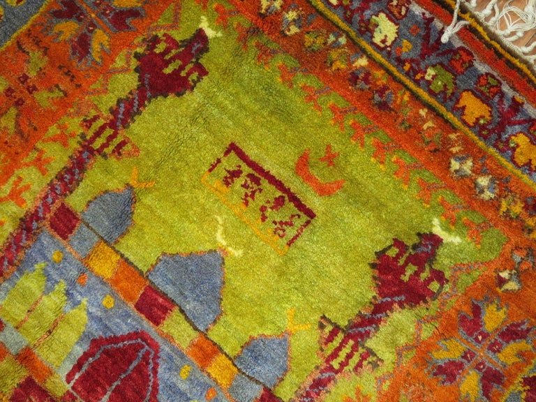 An eclectic Turkish Anatolian intermediate size of runner with a flashy array of electric colors and an abstract design.