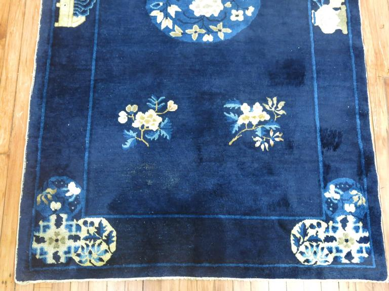 Stunning deep blue and ivory accent full pile condition antique Chinese Peking rug, circa 1920.  Measures: 4' x 6'9