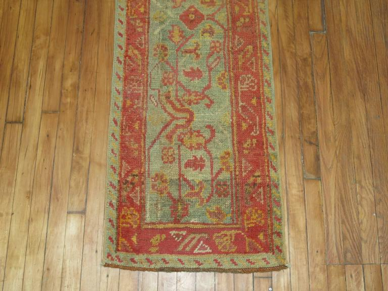 A rare size early 20th century antique Oushak runner in warm colors.