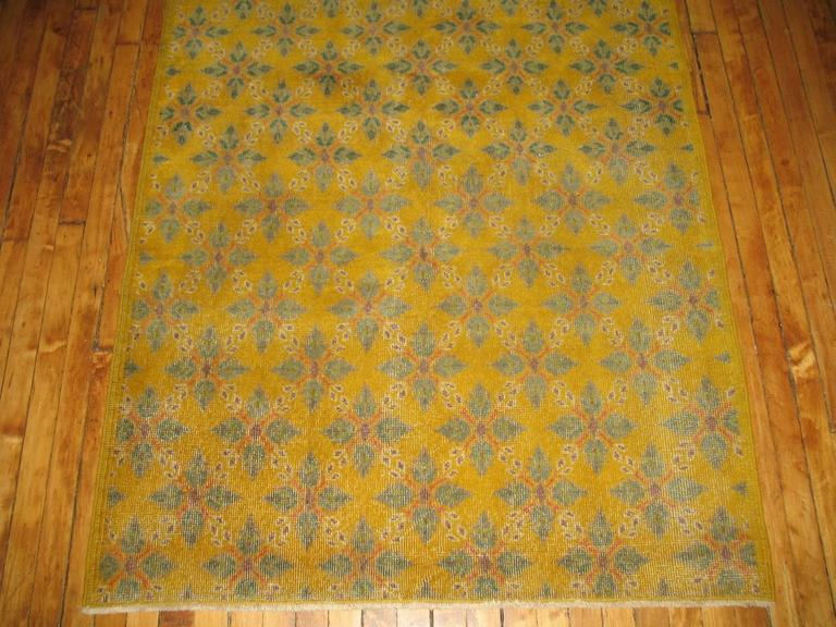 Turkish Anatolian rug with yellow field, accents in pink and green.
