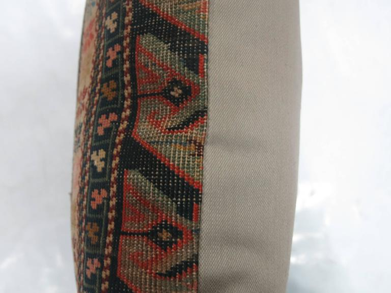Pillow made from an antique Caucasian rug with cotton back. Zipper closure. Age wear.