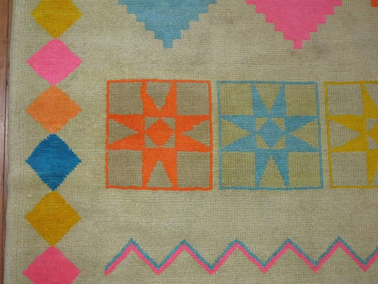 A dynamic colored one of a kind mid-20th century Turkish rug accents in bright pink, orange, blues. We have never seen this design in any rug to this day and its definitely one of our favorite finds in a very long time.
