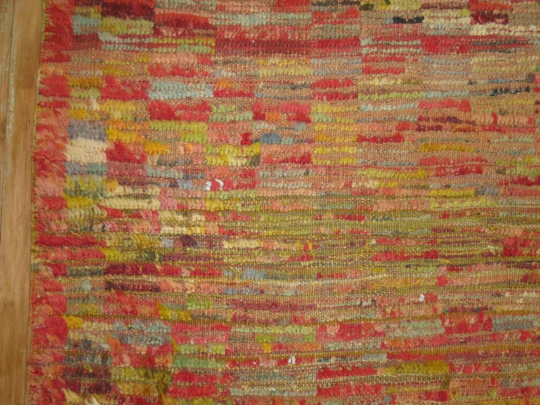 A fun and colorful Mid-Century Turkish Tulu rug with an all-over checkerboard motif.