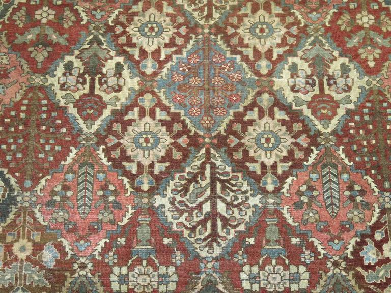 Square size all over design geometric Persian Bakhtiari rug in rustic tones,  circa 1920, measures: 10'3