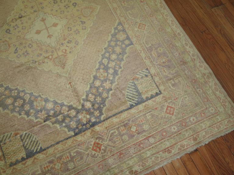 A vintage East Turkestan Samarkhand Gallery rug in icy lavender and pink tones.  6' x 12''