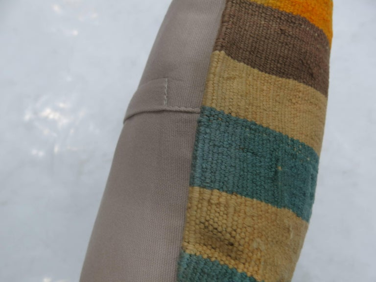Pillow made from a vintage Turkish Kilim with cotton back. Zipper closure and foam insert provided. Measures: 20'' x 20''.