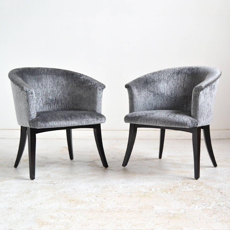 These elegant club chairs are from the period when the reigns were handed from long-time design director Edward Wormley to Roger Sprunger, so we are uncertain which noteworthy designer is the creator of these beautiful chairs.