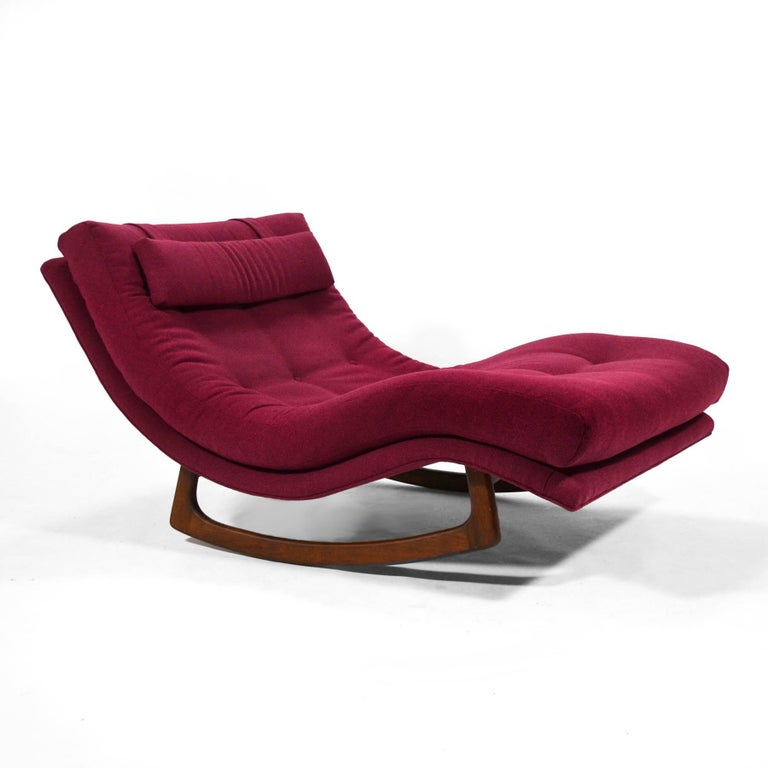 A large and incredibly comfortable chaise with a sculptural walnut base that allows it to rock gently, this design by Adrian Pearsall can be either a statement piece in a living room, or a relaxing seat in a master suite.