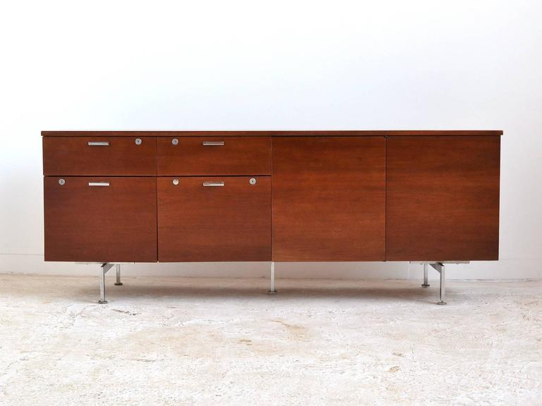 Captivating This Handsome Credenza By Robert John Features A Walnut Case Supported By  Chromed Steel Legs That