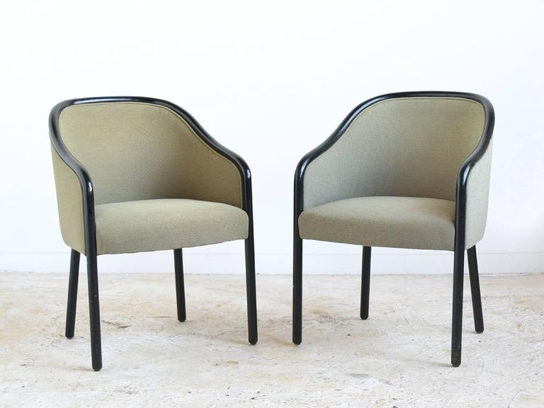 Ward Bennett's highly refined aesthetic combines subtle, graceful shapes and exquisite craftsmanship. The classical proportions of these wood framed armchairs allows them to work in any interior. The black lacquered wood legs and surround provide a