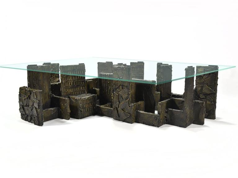 This exceptional coffee table by Paul Evans was a custom order and is the largest we've ever seen of his sculpted bronze series. The architectural base, an arrangement of heavily textured slabs in a beautiful composition, reminds us of a city