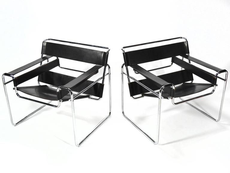 Marcel Breuer's 1925 design is a widely recognized masterpiece of modern furniture, having long ago achieved iconic status. This pair of Wassily chairs date to 1968, the year Knoll Associates became Knoll International, acquired Italian furniture