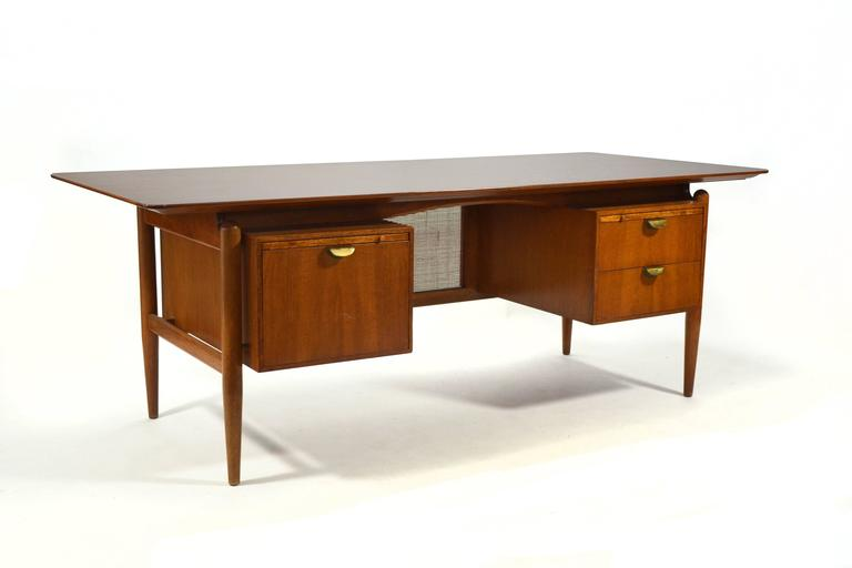 This spectacular desk by Finn Juhl is very rare. Designed for Baker Furniture in the 1950s, it features his signature
